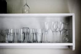 glasses on shelf in Foss Cottage