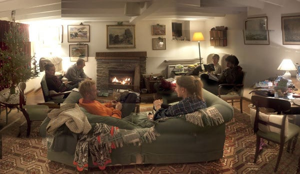 Foss Cottage living room with fire and visitors