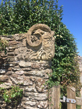 Sculpture of a ram above the gatepost to the garden of our self-catering holiday cottage - Foss Cottage in the coastal village of East Prawle in South Devon